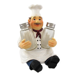 `Bon Apetit` Chef Salt  Pepper Set - This jolly little chef is happy to hold the salt and pepper for you! He measures 6 3/4 inches tall, 5 inches wide, 5 1/2 inches deep and is made of cold cast resin. He is part of a limited edition of 5000 pieces, and is hand-painted to bring out the details. He looks great on the table or on the kitchen counter, and is an excellent addition to your existing decor!