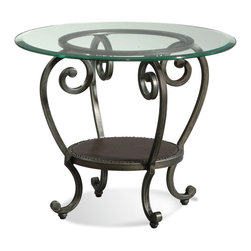 Bassett Mirror - Dauphine Round End Table - You won't want to leave this end table tucked in a corner. Let its unique character take the spotlight and show off the whimsical curls, leather-covered shelf and beveled-edge glass top.