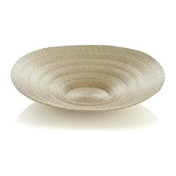 Natural Centerpiece Bowl - A lighter shade of palm, intricately hand-woven by Mexican artisans, this dramatic low bowl takes center stage on a tabletop or console. A great place to showcase seasonal decorations such as seashells or beach glass.