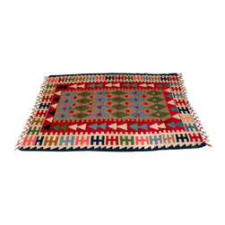 """Wool Kilim Carpet - Turkish - Turkish wool area rugs add warmth, color and culture to the home. Turkish kilim style carpet is made of 100% handspun wool dyed in rich, vibrant colors.  Handwoven in patterns unique to the tribes of the old Anatolian regions where various motifs and symbols woven into the carpet tell a weaver's story. Turkish wool rugs add a cozy, decorative touch in any room throughout the home. They also make nice rustic cabin or lodge accent rugs or used creatively as a carpet wall hanging. Flatweave wool area rug is approximately 44""""x 63-1/2""""; Made in Turkey."""
