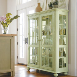 Stanley-Coastal Living - Newport Storage Cabinet - Beautifully display all of your dishes and collectibles with the spacious Newport Storage Cabinet from Stanley Coastal Living. A mirrored back and four glass shelves rest behind seeded glass doors, adding light to any room. Covered in a delicate sea grass finish, this shabby-chic piece creates a familiar and inviting atmosphere in any home. Perfect for use in a dining room, entryway, or kitchen, this unique curio cabinet instantly adds functional storage space where you need it most.
