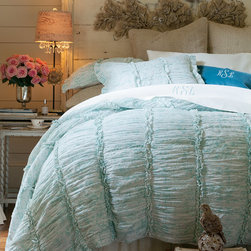 Colette Quilt - Our Colette ensemble brings together some of our favorite attributes: sumptuous texture, elegant patterning and exquisite attention to detail. Our most romantic bedding collection to date, airy cotton voile showcases an abstract woodblock pattern in soft, tranquil tones. Ruched panels create rich textural dimension while double-ruffle insets and stitch accents add a feminine flourish.