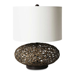 Vertuu Design - Rocco Lamp - Add a touch of island style to your home with the simple Rocco Lamp. Its brown woven rattan base and smooth white drum shade give the piece a clean, bright look that pairs well with tropical decor. Requires 60 watt maximum bulbs, bulbs not included.