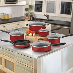 Cuisinart - Cuisinart Advantage Non-Stick Aluminum 11 pc. Cookware Set - Red - 55-11R - Shop for Cookware Sets from Hayneedle.com! Cook with style and ease by adding the Cuisinart Advantage Non-Stick Aluminum 11 pc. Cookware Set Red. This beautiful set will add pop to your kitchen with its durable aluminum construction and bold red finish. These pans feature an aluminum core that offers even heating while a premium non-stick coating lets foods glide right off and makes cleaning a snap. Easy grip silicone handles stay cool even when your recipes are hot. Tapered lids offer less mess with drip-free pouring. Tempered glass lids let you keep an eye on your food while sealing in flavor. Each piece is oven safe up to 350 degrees and dishwasher safe. Set Includes: 1-qt. sauce pan with lid 2-qt. sauce pan with lid 3-qt. sauce pan with lid 3-qt. saute pan with lid 6-qt. sauce pot with lid and 10-inch skillet. About CuisinartOne of the most recognized names in cookware and kitchen products Cuisinart first became popular when introduced to the public by culinary experts Julia Child and James Beard. In 1973 the Cuisinart food processor revolutionized the way we create fine food and healthy dishes and since that time Cuisinart has continued its path of innovation. Under management by the Conair Corporation since 1989 Cuisinart is a universally celebrated name in kitchens across the globe. With a full-service product line including bakeware blenders coffeemakers cookware countertop appliances kitchen tools and much much more Cuisinart products are preferred by chefs and loved by consumers for durability ease of use superior quality and style.