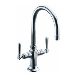 """Kohler - Kohler K-7342-4-BS Brushed Stainless HiRise HiRise stainless two - HiRise- stainless two handle bar sink faucetThe HiRise Collection uniquely combines elements of vintage plumbing vernacular with the strength and beauty of solid stainless steel to create a truly sophisticated design that generates a level of comfort in both heritage and urban loft environments. A design that is both upscale and highly functional. The complete HiRise Collection includes product configurations for primary, secondary and entertainment sink applications. The single hole two handle bar or secondary sink faucet creates a clean, classic look and is perfectly sized to compliment smaller bar or secondary sink applications.     Two handled single hole bar or secondary sink faucet  Unique styling is equally at home in both traditional and utilitarian kitchen designs  Complete line of configurations for primary, secondary and entertainment sink applications  Solid Stainless Steel construction for authentic aesthetics and superior durability  Spout rotates 360 degrees with superior 8-1/4"""" clearance below spout for large glasses or vases  Brushed stainless and new polished stainless finish options  ADA compliant lever handles for ease of operation  Utilizes Kohler installation ring and flexible connections for ease of installation  Kohler ceramic disk valves exceed industry longevity standards by over two times, ensuring durable performance for life"""