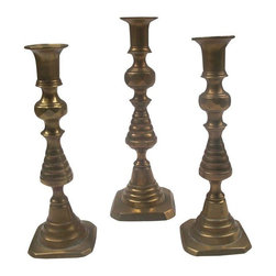 "Antique Brass Candle Holders -  Set of 3 - This set of three antique brass candle holders has a graceful silhouette and wonderful patina. The tall one has ""England"" is stamped onto the base with the reference number 223580.  1 Tall: 10""h x 3.5""w 2 Small: 9""h x 3""w"