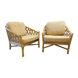 Used Bamboo Lounge Chairs by McGuire Furniture - A Pair - Take a seat on this pair of bamboo and rattan lounge chairs by McGuire Furniture from the 1970s. The  split bamboo in a trellis-like pattern is surrounded by a rawhide-wrapped bamboo frame. The frames are sturdy and structurally sound and the seat webbing is tight, while the finish is in very good vintage condition with minor wear. However, the cushions need to be reupholstered because the fabric is worn. This is going to be a fun project for the future (and lucky) owner!