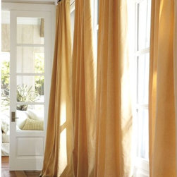 Velvet Drape, Wheat - Yellow velvet panels would anchor the space while creating a warm, welcoming room.