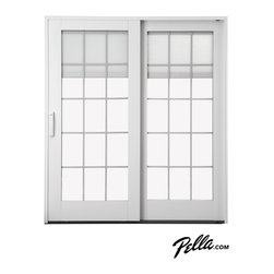 Pella® Designer Series® Sliding Patio Door - Pella® Designer Series® ENERGY STAR®-qualified sliding patio doors offer a variety of custom options, including convenient between-the-glass blinds that stay protected from dust and damage, even as you're going in and out or your family, friends, and pets do, too.