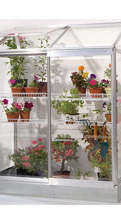 Lean-To Greenhouse - Think you don't have the space for a garden?  If you have a little wall space outdoors, you can have a garden with this adorable little lean-to greenhouse.  The three sides are made of UV polycarbonate panels.