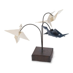 Crane Sculpture - This Crane sculpture is inspired by the mighty yet delicate origami cranes feature as garlands, decorations and the occasional necklace in every corner of the world. We made each crane from reclaimed metal by hand-cutting, welding and bending the metal into shape.