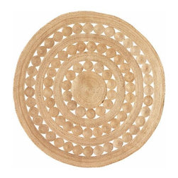 Soleil Round Hemp Rug - This rug is eco-friendly and perfect for the boho-chic bedroom.
