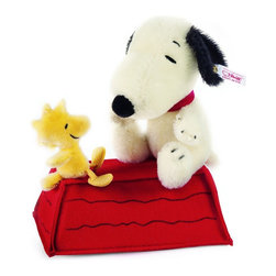 Snoopy And Woodstock On Rooftop EAN 682360 - Charles Schulz, creator of the famous Peanuts comics, once said that the best idea he ever had in the strip was to move Snoopy from inside his doghouse to the rooftop. On April 4, 1967, Schulz made another wonderful decision: to give Snoopy a sidekick and assistant in the form of Woodstock. At Steiff North America, we've brought these two iconic pop culture icons together once again for a very special collectible item. It's Snoopy and Woodstock enjoying each other's company on the doghouse roof. Both Snoopy and Woodstock are made from genuine mohair. The doghouse is sewn from 100% wool felt and features silkscreened details. As a part of our ongoing series of Peanuts collectibles, this is one treasure you won't want to miss