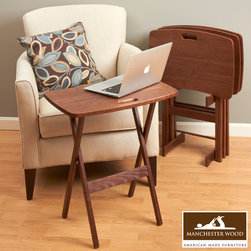 Portable Folding Tray Table Desk Set of 4 by Manchester Wood - Practical… Sturdy… Portable. We combined the two most popular designs of our folding TV tray tables – the Contemporary and Portable Folding Work and Laptop Desk to offer you an exclusive variation made perfect for the home or office space. Crafted from sustainable Northeast hardwood at our mill in the Adirondack foothills of New York; built to last generations.