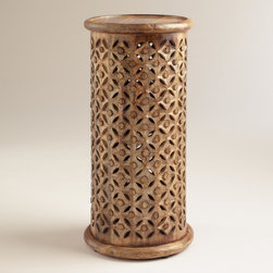 World Market - Tall Tribal Carved Accent Table - Hand carved of mango wood by artisans in India, our Tall Tribal Carved Accent Table lends an eclectic look to any space. Its surface is perfect for a lamp, vase of flowers, plant or picture display.