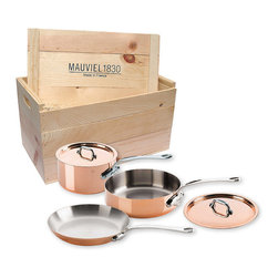 Frontgate - Mauviel M'Heritage Copper 5-pc. Cookware Set - Includes 2-quart saucepan with lid, 3.2-quart sauté pan with lid, and 10.2-inch fry pan. Pans are carefully bi-laminated of 90 percent copper and 10 percent 18/10 stainless steel. Easy-to-clean stainless steel preserves the taste and nutritional qualities of food. Tight-fitting lids seal in flavors, moisture, and nutrients. Pans have stainless-steel handles and 1.5mm thick copper exterior. The Mauviel M'Heritage Copper 5-piece Cookware Set is an excellent value that offers an ideal mix of pots and pans for all types of cooking, from sauteing to sauce-making and slow roasting. Prized for its ability to heat up evenly and rapidly and to cool down quickly, Mauviel's genuine French copper cookware combines copper and stainless steel to allow for the precise timing, maximum control, and easy care that is ideal for all daily cooking needs. Includes 2-quart saucepan with lid, 3.2-quart saute pan with lid, and 10.2-inch fry pan .  .  .  .  . Ideal for use on electric and gas cooking surfaces, and in the oven and broiler . Made in France and used by professionals and household cooks throughout the worldSee how to care for your Mauviel cookware. . Manufacturer lifetime guarantee .