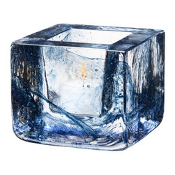 Kosta Boda - Brick Votive, Blue - The Brick series reflects the distinct features of a brick, yet with the transparency of glass. This design features splashes of blue that make each votive unique.