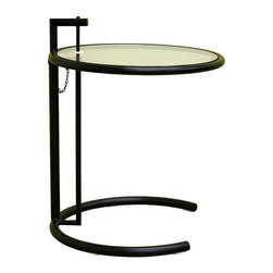 Wholesale Interiors - Baxton Studio Metal and Glass Accent Table with Adjustable Height - Classic Baxton Studio end table is an affordable reproduction of the world-famous design. Ingenious adjustable-height table can be raised and lowered to eleven different positions, making it ultimately versatile. Contemporary design features the distinctive curved C base in smooth painted black metal finish, and the top glass is tempered for safety. As fascinating today as when it was first introduced in the glamorous Art Deco era, this fabulous table will never be out of style. Glass and steel, versatile and stylish � this modern side table has a distinctive niche. The frame of the steel table is finished in black and is an interplay between the classic circular shapes of the base and top and the straight lines in the supporting posts. The tabletop itself is tempered glass and is seemingly suspended atop the frame. You will be able to adjust the height of the table by placing the metal peg in the holes within the frame, or, if the lowest height is desired, the peg will hang freely from the frame as part of the design.