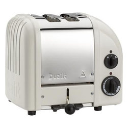 Dualit® NewGen Canvas White 2-Slice Toaster - A toast to retro-inspired design, hand-assembled in England and designed for commercial use. Insulated stainless steel in a stylish two-tone finish of satin stainless and canvas white is embossed with the Dualit logo. Variable controls include defrost and the option to toast buns or bagels in the extra-wide slots. Selector controls heat in either or both sides. With a patented design for increased efficiency and longevity, each toaster features a removable crumb tray and adjustable rear foot.