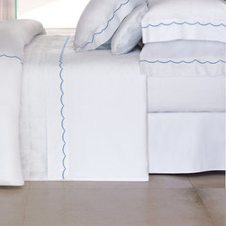 """Frontgate - Yves Delorme Douce Fitted Sheet - Yves Delorme has been a family-owned purveyor of fine linens since 1845. Made in France of Egyptian cotton, sateen woven for luxurious softness. 300 thread count. Solid-white sateen 18"""" deep fitted sheet with elastic on all sides. Simple design pairs well with other bedding items. Our Yves Delorme Douce Fitted Sheet brings a charming, delicate approach to the all-white, hotel-style embroidered bedding ensemble. . . .  . . Knife-edge duvet cover has button closure. Pair with the Yves Delorme solid-white sateen 18"""" deep fitted sheet with elastic on all sides. Machine wash and tumble dry low; see product label for further instructions."""
