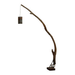 ReCoop Designs - Cypress Floor Lamp - This unique floor lamp was created using a limb of Cypress that we pulled from the Brazos River just south of Houston, TX. The limb is supported by a very thick steel flange base made from salvaged steel collected from a local scrap yard. The base of the limb has solid steel rods that are mortised into the limbs base creating a rock solid fixture. The light is wired with a tan rayon fabric cord which ties into an aged brass light socket. The lamp shade is a vintage expanded steel burner cover from an industrial water heater salvaged from a local Houston warehouse which gives off a very nice glow when paired with a low wattage filament bulb. This piece is perfect next to a chair, desk, bed, or even as mode lighting.