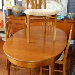 "Mid-Century Modern & Vintage Furniture - SOLD. Teak, mid-century modern dining table with pop-up leaf and four chairs by ""G Plan"" in England. Table is 5' long x 3' wide without leaf."