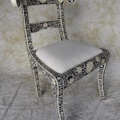eclectic chairs by Mecox Gardens
