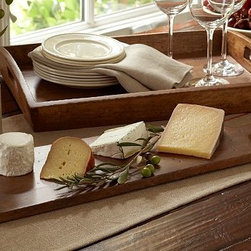 "Vintage Wood Long Cheese Board - Create a bit of the wine country wherever you are with our rustic Wood Cheese Board. Cheese Board (shown): 8.5"" wide x 12"" long x 0.5"" high Long Cheese Board: 8.5"" wide x 25"" long x 0.5"" high Hand made of sustainably harvested mango wood. Monogramming is available at an additional charge. Monogram will be centered along the end of the board."