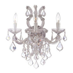 Crystorama - Wall Sconce - There's undeniable magic when light meets crystal or glass. It sparks the same fire one sees when light meets precious and semi-precious stones. Great lighting often takes styling cues from jewelry as well, with its primary use of gold and silver tones. Just like an outfit isn't complete without the perfect necklace, bracelet or earrings, a room isn't complete until it has lighting that adds the WOW factor when you walk in.
