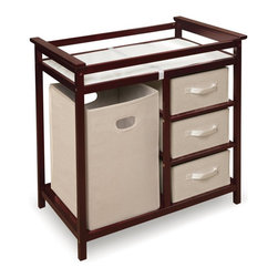Badger Basket - Badger Basket Modern Changing Table - 02502 - Shop for Changing Tables from Hayneedle.com! Keep baby and the nursery clean and tidy in one step by purchasing the Badger Basket Modern Changing Table. Constructed of wood and wood composites this changing table is equipped with an integrated hamper bag and three pull-out storage baskets. Dirty laundry and baby's socks onesies and creams will always have a home here. A polyurethane foam changing pad on top comes with a safety belt and rails on each side for added security but never leave baby unattended.