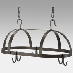 Oval Dutch Pot Rack with 6 Slip Hooks - Small - Loft and apartment dwellers often find themselves short on cabinet space in the kitchen which makes a pot rack the perfect solution for modern living. Our Oval Dutch Pot Rack with Six Slip Hooks has a clean contemporary design and adds convenience to your kitchen. Three double slip hooks free up cabinet space by allowing you to hang your most-used pots and pans - the ideal space-saving addition to your kitchen. Crafted from hand-forged iron this pot rack has a clean attractive style in an oval shape and the natural black finish will blend in beautifully with any kitchen decor. The three double slip hooks are loose allowing you to place them in any configuration around the rim and you can purchase additional 1-foot sections of chain to accommodate high ceilings. Made in the USA. Dimensions: 24L x 13W x 11H inches. Weighs 20 pounds.About Stone County Ironworks.Stone County Ironworks creates heirloom hand-forged iron furniture. The company's blacksmiths use artistic ability and traditional tools like the hammer anvil and forge to create unique works of art naturally. For 30 years Stone County Ironworks has worked with designers and dreamers all over the country - sometimes forging through a completed drawing provided by a client and sometimes working only with an idea to discover and create just the right design. The company's quality workmanship that reflects the skill of the blacksmith continues to set it apart from other manufacturers.