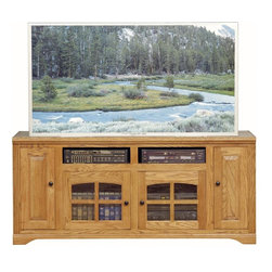 Eagle Industries - Oak Ridge 4 Doors Entertainment Console (Light Oak) - Finish: Light Oak. Two arched glass panel doors. Two raised panel doors. Two fixed wood shelves. Designed with decorative molding and fluted detailing. Warranty: Eagle's products are guaranteed against material defects for one year from date of delivery to the dealer. Made in USA. No assembly required. 66 in. W x 17 in. D x 32 in. H (114.7 lbs.)The Oak Ridge collection combines American oak hardwood with updated contemporary styling. Heavy crown molding, sleek lines, fluted side molding, black brushed metal hardware, solid oak frames and solid oak recessed doors give this transitional collection a style all its own