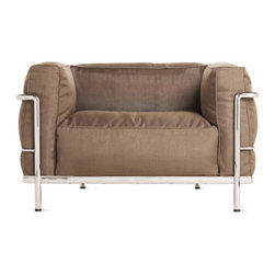 """Outdoor LC3 Grand Modele Armchair - The Le Corbusier group referred to their LC2 and LC3 collections (1928) as """"cushion baskets,"""" which they designed as a modernist response to the traditional club chair. These pieces reverse the standard structures of sofas and chairs by having frames that are externalized. With thick, resilient pillows resting within the steel frames, the idea was to offer all the comfort of a padded surface while applying the elegant minimalism and industrial rationale of the International Style. The LC Series was originally designed for indoor use, but after a visit to Villa Savoye, where some of the pieces were being used on the outdoor terrace, Cassina was inspired to create outdoor-safe models. The manufacturer spent 3 years working closely with the LC Foundation to develop a product that was within the foundation's parameters: To be """"the same or better quality than indoor."""" Cassina opted for better, using hand-polished AISI 304 stainless-steel with silver welding, as opposed to chrome, to construct the frames – a material with extreme resistance to corrosion that is actually more authentic to the product; chrome was not used until the 1970s/-80s. The silver welding will patina over time and develop a halo. The cushions are covered in durable, waterproof Sunbrella® fabric and wrapped in """"Ecofill"""" – a hypoallergenic, biodegradable hollow fiber that dries quickly. Plein Air and Sling fabric are also resistant to atmospheric agents and UV rays. Each piece is signed and numbered and, as a product of Cassina's Masters Collection, is manufactured by Cassina under exclusive worldwide license from the Le Corbusier Foundation. Includes a protective, water-repellant cover. Made in Italy."""