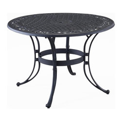 HomeStyles - Round Dining Table in Black (42 in. Diam x 29, 42 in. Diam X 29 in. H - Choose Table Size: 42 in. Diam x 29 in. HHand antiqued powder coat finish. Sealed with a clear coat to protect finish. Patterned round table top. Center opening to accommodate umbrellas. Nylon glides on all legs. Stainless steel hardware. Made from cast aluminum. 42 in. Dia. x 29 in. H. Warranty. Assembly InstructionsWith its intricately designed metal work, our outdoor table will certainly become the focal point of the deck or patio! Need an added incentive? It's maintenance free!