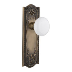 Nostalgic - Nostalgic Passage-Meadows Plate-White Porcelain Knob-Antique Brass (NW-701875) - Meadows Plate with White Porcelain Knob With Keyhole - Passage