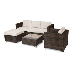 "Reef Rattan - Reef Rattan 4 Piece Conversation Sofa Set - Chocolate Rattan / Beige Cushions - Reef Rattan 4 Piece Conversation Sofa Set - Chocolate Rattan / Beige Cushions. This patio set is made from all-weather resin wicker and produced to fulfill your needs for high quality. The resin wicker in this patio set won't fade, shrink, lose its strength, or snap. UV resistant and water resistant, this patio set is durable and easy to maintain. A rust-free powder-coated aluminum frame provides strength to withstand years of use. Sunbrella fabrics on patio furniture lends you the sophistication of a five star hotel, right in your outdoor living space, featuring industry leading Sunbrella fabrics. Designed to reflect that ultra-chic look, and with superior resistance to the elements in a variety of climates, the series stands for comfort, class, and constancy. Recreating the poolside high end feel of an upmarket hotel for outdoor living in a residence or commercial space is easy with this patio furniture. After all, you want a set of patio furniture that's going to look great, and do so for the long-term. The canvas-like fabrics which are designed by Sunbrella utilize the latest synthetic fiber technology are engineered to resist stains and UV fading. This is patio furniture that is made to endure, along with the classic look they represent. When you're creating a comfortable and stylish outdoor room, you're looking for the best quality at a price that makes sense. Resin wicker looks like natural wicker but is made of synthetic polyethylene fiber. Resin wicker is durable & easy to maintain and resistant against the elements. UV Resistant Wicker. Welded aluminum frame is nearly in-destructible and rust free. Stain resistant sunbrella cushions are double-stitched for strength and are fully machine washable. Removable covers made with commercial grade zippers. Tables include tempered glass top. 5 year warranty on this product. Three Seater Sofa: W 71"" D 29"" H 27"", Chair: W 29"" D 29"" H 27"", Coffee Table: W 25"" D 25"" H 13"", Ottoman: W 25"" D 25"" H 13"""