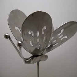 Handmade Stainless Steel Butterfly Plant Stake - This little butterfly is creative and fun. I can see it in a plant, reflecting sunshine to create a decorative addition to any potted plant or bare nook in a garden.