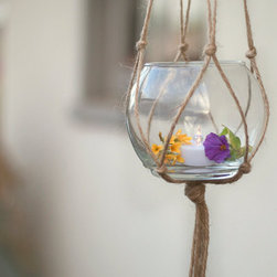 Hanging Candle Holder, Hanging Vase Holder by Leslie Palafox - I would love to fill a backyard with a dozen of these hanging holders. For a brunch, I would fill them with water and float a peony. At night, I would add little votives. But, honestly, my most favorite idea would be to hang one in my daughter's room for her goldfish.