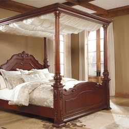 Ashley - Signature Design by Ashley Martanny Brown/ Cherry Poster Bed - Enjoy the traditional style the Martanny canopy bed brings your bedroom. Featuring cream colored drapes and a warm brown finish that helps complement the room.