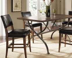 Hillsdale Cameron 5 Piece Counter Height Rectangle Wood Dining Table Set with Pa - With both traditional and modern touches the Hillsdale Cameron 5 pc. Counter Height Rectangle Wood Dining Table Set with Parson Chairs makes a perfect choice for any dining room. This set includes a counter-height table with a metal trestle base and wood top and four counter stools with a sturdy wood construction and faux leather upholstery. About Hillsdale FurnitureLocated in Louisville Ky. Hillsdale Furniture is a leader in top-quality affordable bedroom furniture. Since 1994 Hillsdale has combined the talents of nationally recognized designers and globally accredited factories to bring you furniture styling and design from around the globe. Hillsdale combines the best in finishes materials and designs to bring both beauty and value with every piece. The combination of top-quality metal wood stone and leather has given Hillsdale the reputation for leading-edge styling and concepts.