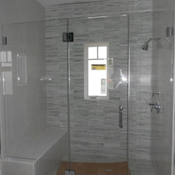 """ATM Mirror and Glass - Frameless Glass Shower Enclosure - Fully frameless shower enclosure, using 3/8"""" starphire low iron glass.  Door opens in 90 degrees and out 90 degrees.  All fittings solid brass construction- chrome plated. Glass clamp method."""