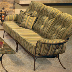 Monterra Wrought Iron Outdoor Sofa - The Monterra outdoor sofa has a wrought iron frame and matching lounge chairs and coffee table.