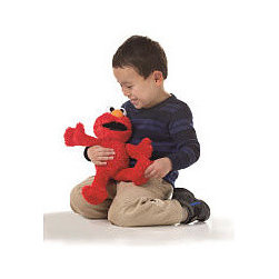 """Sesame Street Tickle Time Elmo - Hasbro - Toys """"R"""" Us - Let your child engage in tickling fun with Playskool Sesame Street Tickle Time Elmo. Soft and cuddly Elmo says silly phrases and makes laughing sounds as your little one squeezes his tummy or presses his feet. The faster he is tickled, the more he laughs and shakes!"""