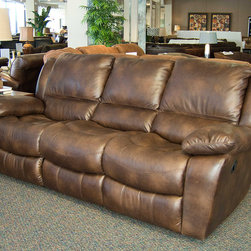 Rafferty Idaho Brown Reclining Sofa - The sofa's curved seating offers the utmost contentment while the padded arm rest creates the same feeling. With additional plush support for your legs, all elements add up to pure luxury.