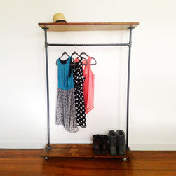 Adam's Morgan Garment Rack - When closet space is limited, this rolling garment rack is a great way to hang your clothes, shoes, and other accessories. Perfect to use in your bedroom or entryway, its rolling casters make it easy to move as needed. Each piece is one of a kind and crafted with black iron piping and reclaimed wood from the Philadelphia/DC/NYC area.