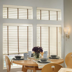 "M&B Olympian 2-3/8"" Wood Blinds - The rich, natural beauty of handcrafted wood blinds will add warmth, beauty and individual character to any room. Wood choices include a complete palette of whites, neutrals and rich stains. Our unique collection of decorative styles includes rustic wood, sandblasted wood, and a new enhanced grain wood with an elegant tone-on-tone appearance. Our new bamboo woods are wonderful for casual or elegant settings. Bamboo is a great blend with many flooring and cabintry styles. The decorative 3"" valance that is standard with every blind provides a finished look."