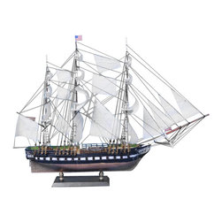 Handcrafted Nautical Decor - USS Constitution Limited 20'' - --SOLD FULLY ASSEMBLED--Ready for Immediate Display - Not a Model Ship kit--With exquisitely fine craftsmanship,   unmatched features and careful attention to every detail, these scale   replica tall ship models of the USS Constitution are certain to   please even the most discriminating enthusiast of naval history.   Whether the highlight of an office or den, or the centerpiece of a   nautical themed meeting room or family living room, �Old Ironsides� will evoke wonder at her manifest detail and inspire historical pride with her indomitable spirit.--20'' Long x 4'' Wide x 18'' High (1:64 scale)----    Handcrafted by our master artisans--    Individual copper finished plates below the waterline --    Museum Quality features not available in other tall ship models--    --        Accurate beakhead design and       scrollwork--        Detail is accurate to scale see deck features and cannon carriages--    --    --    Two metal anchors weigh aside the bow--    Amazing Details, including:--    --        Authentic scale lifeboats--        22 sails hold their shape and do not wrinkle --        Taut rigging with varied       thread gauge and color--    --    ------�