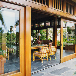 Quantum Windows & Doors | Hill|Glazier Architects - A considerable amount of Quantum handcrafted wood products are featured here at this prominent island paradise. Seven buildings in total were equipped with custom Lift & Slide doors, Slide & Fold doors and louvered transom windows, all made of rich Honduran Mahogany. Keeping with Quantum's commitment to exceptional customer service, our project management team provided jobsite training on the process of installing the massive door systems.
