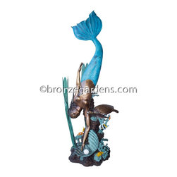 """Bronze Mermaid - An exceptional piece highlighting the treasures under the sea, this bronze is magnificent.  Within the piece you find a mermaid is searching for her magical pearl.  The detail of the other sea life is breathtaking and very realistic with the addition of vibrant colors to the patina of the bronze.  There is a sea turtle, corral, reef fish and sea weeds all depicted with great art.  This piece is 97"""" tall."""