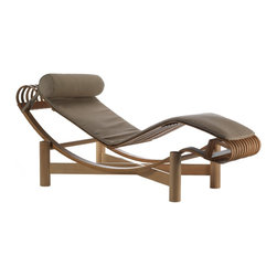 Cassina - Outdoor Tokyo Chaise Lounge - Although best known for her elegant modernist tubular steel furniture of the 1920s and 1930s, Charlotte Perriand also experimented with materials and produced craft-based designs during the three decades spent collaborating with Le Corbusier Group. In 1940, while living and working in Japan, Perriand conceived of the Outdoor Tokyo Chaise Lounge, a reinterpretation of Le Corbusier's LC4 Chaise Longue -– but it was never produced. That is, until now. In 2012, more than 60 years later, Tokyo is in production for the first time. Available in bamboo, teak or beech wood, Tokyo is a fanciful combination of nature and the rational aesthetic of the International Style. Sitting atop a solid-wood base, its seat is composed of 12 curved wooden strips, which are connected to the curved bars below using satin brass studs. The seat pad and headrest are covered in waterproof, UV-resistant Sunbrella® fabric. Each piece is signed and numbered and, as a product of Cassina's Masters Collection, is manufactured by Cassina under exclusive worldwide license from the Le Corbusier Foundation. Made in Italy. A protective, water-repellant cover is included.